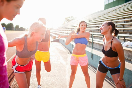Stock Photo: 1828R-79375 Teenagers Stretching at Race Track, Lake Oswego, Oregon, USA