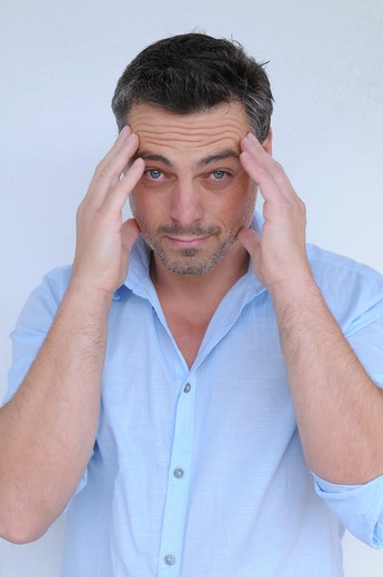 Stock Photo: 1828R-80372 Man with Hands on Head