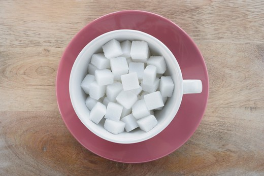 Stock Photo: 1828R-81323 Cup of Sugar Cubes