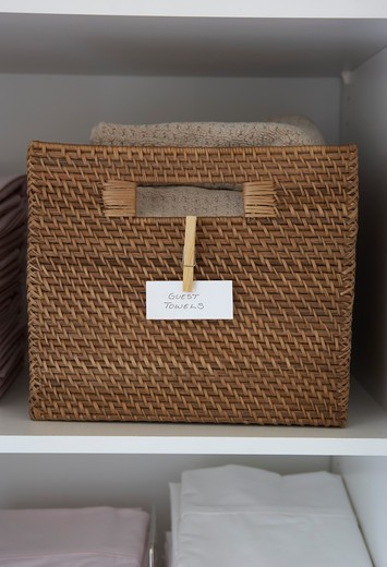 Stock Photo: 1828R-81730 Basket of Towels in Linen Closet
