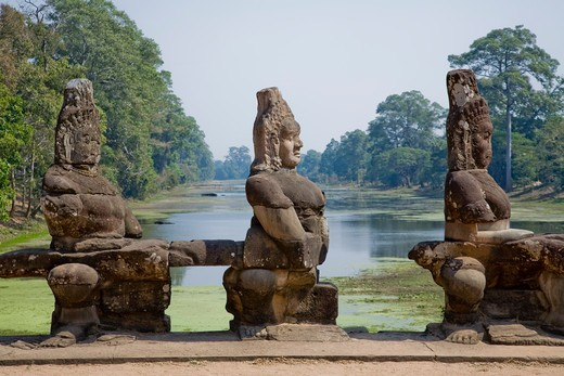 Stone Asuras lining Bridge near South Gate to Angkor Thom, Cambodia : Stock Photo