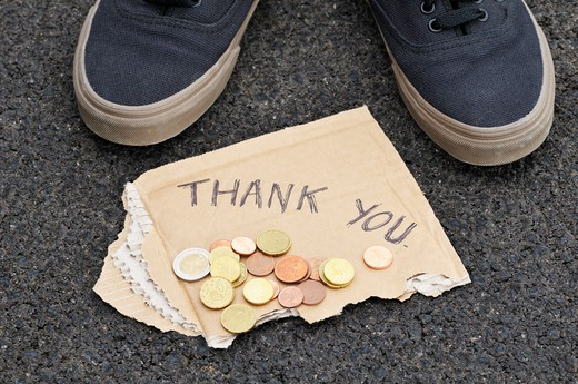 Feet with Spare Change and Thank You Sign : Stock Photo