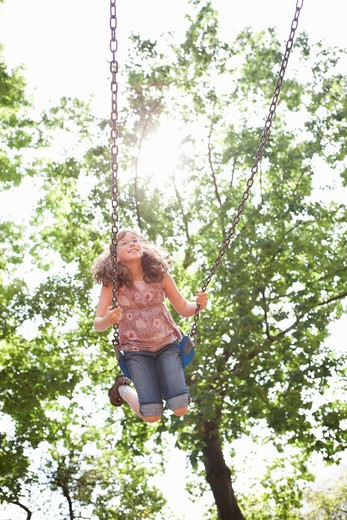 Stock Photo: 1828R-83632 Girl Playing on Swings, Washington Park Playground, Portland, Oregon, USA