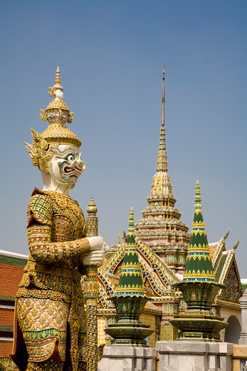 Stock Photo: 1828R-83735 Guardian Demon and Temple Offerings, Wat Phra Kaew, Grand Palace, Bangkok, Thailand