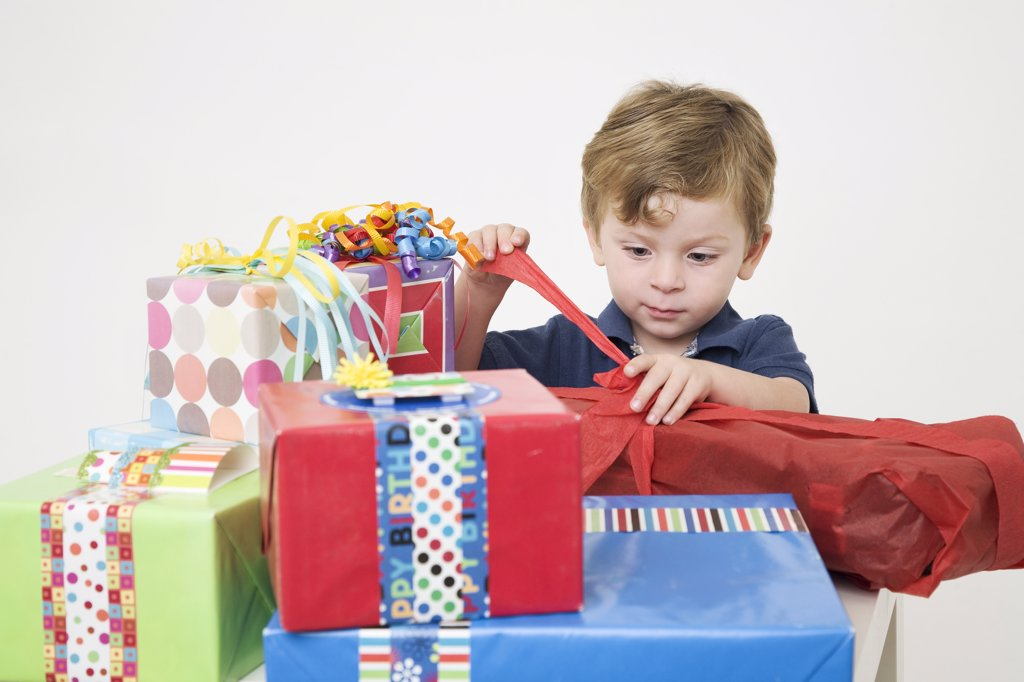 Young Boy opening Birthday Presents : Stock Photo