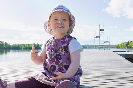 Stock Photo: 1828R-85022 Girl on Dock