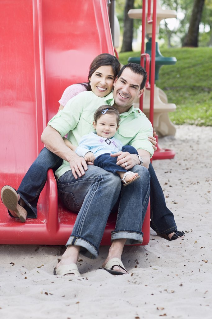 Family on Slide : Stock Photo
