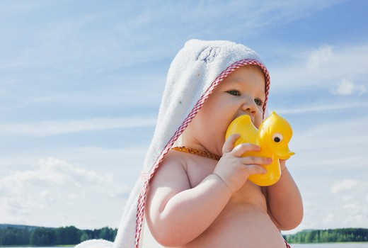 Baby Girl with Rubber Duck : Stock Photo