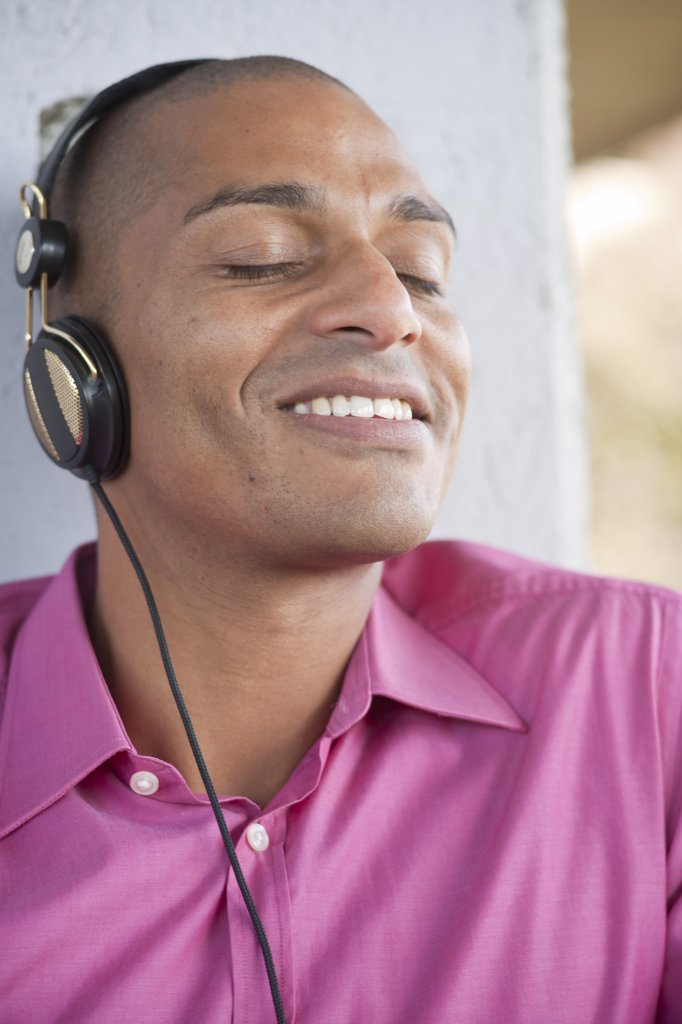 Stock Photo: 1828R-86315 Close-up Portrait of Man using Headphones