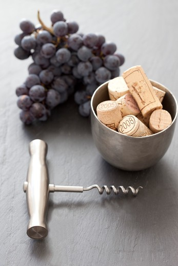 Stock Photo: 1828R-86457 Corkscrew, Grapes and Corks