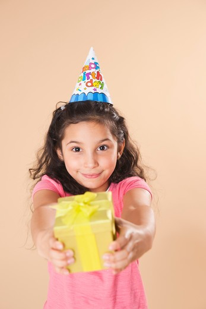 Portrait of Girl Holding Gift : Stock Photo