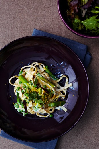 Fettuccine Alfredo with Asparagus and Peas on Plate : Stock Photo