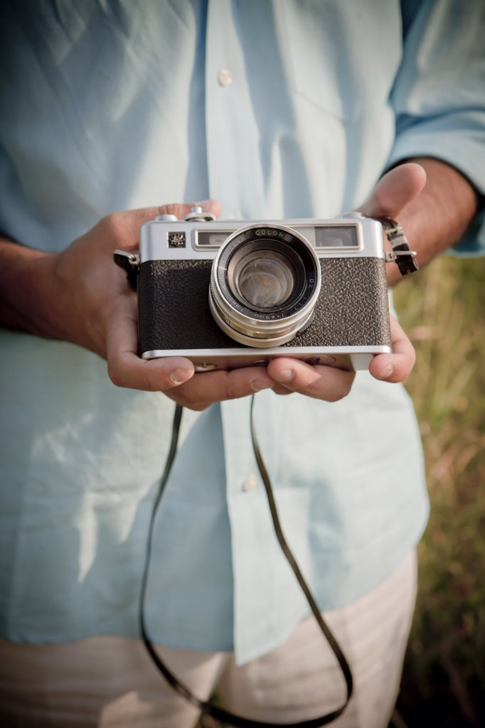 Close-up of Man holding Vintage Camera : Stock Photo