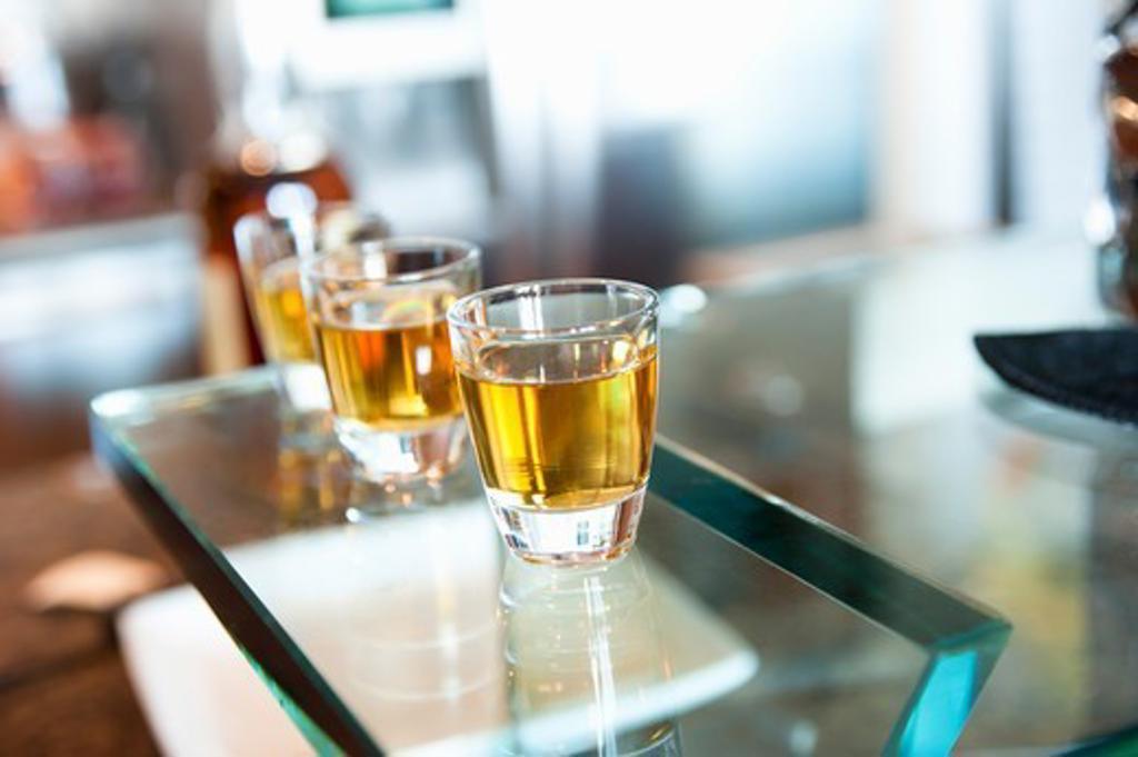 Stock Photo: 1828R-88128 Drinks on Glass Table, Toronto, Ontario, Canada