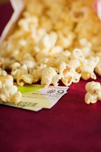 Stock Photo: 1828R-88143 Popcorn and Movie Tickets