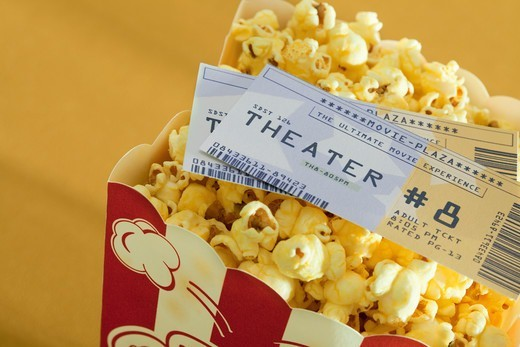 Stock Photo: 1828R-88148 Movie Tickets and Popcorn