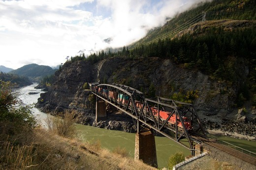 Freight Train Crossing Cisco Bridge over Fraser River, British Columbia, Canada : Stock Photo