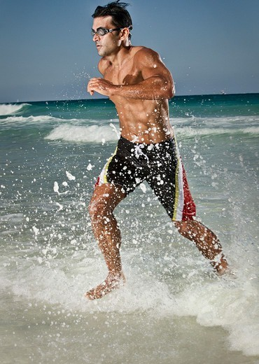 Stock Photo: 1828R-88841 Swimmer Running out of Water, Miami Beach, Florida, USA