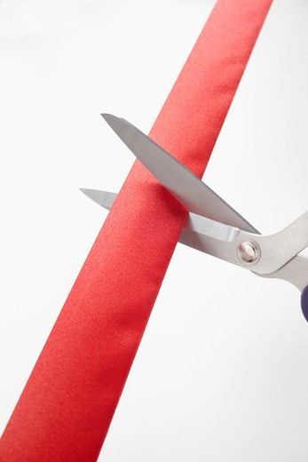 Stock Photo: 1828R-88865 Scissors Cutting Red Ribbon