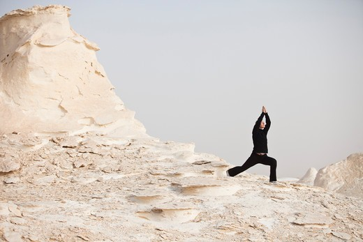 Woman doing Yoga, White Desert, Farafra, Egypt : Stock Photo