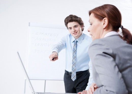 Stock Photo: 1828R-89252 Young Businessman giving Presentation to Businesswoman
