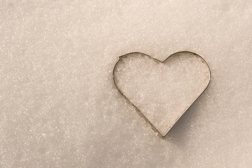 Stock Photo: 1828R-89394 Heart-Shaped Cookie Cutter in Snow