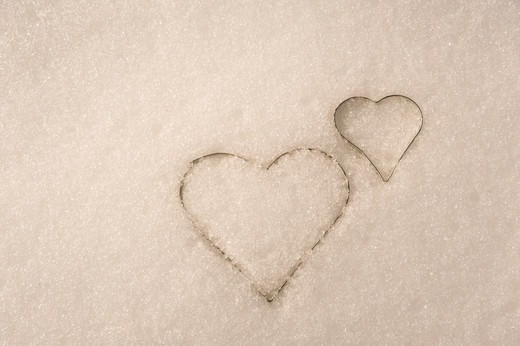 Stock Photo: 1828R-89395 Heart-Shaped Cookie Cutters in Snow