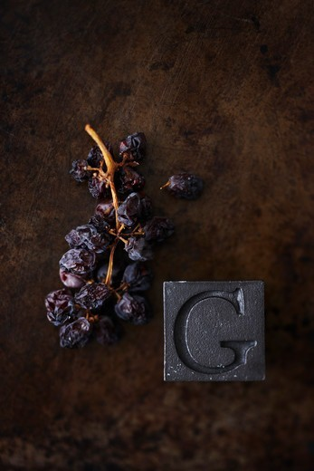 Dried Grapes and Letter G : Stock Photo