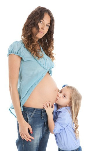 Stock Photo: 1828R-90049 Pregnant Mother and Daughter