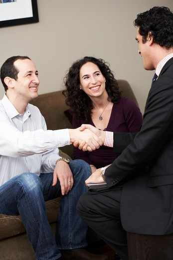 Businessman Meeting with Couple : Stock Photo