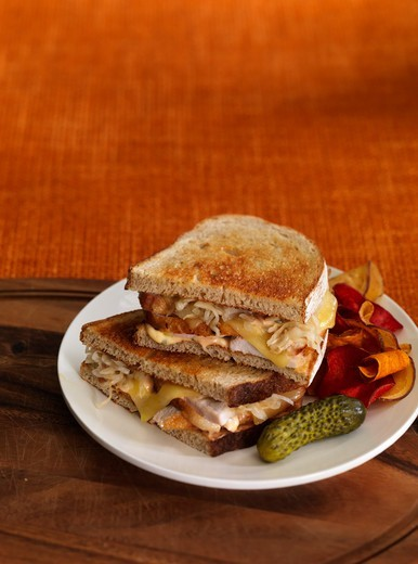 Stock Photo: 1828R-90176 Turkey Reuben Sandwich with Pickle and Vegetable Chips
