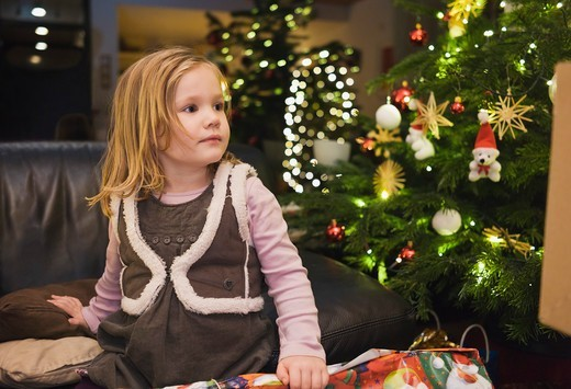 Girl on at Home with Christmas Tree, Germany : Stock Photo
