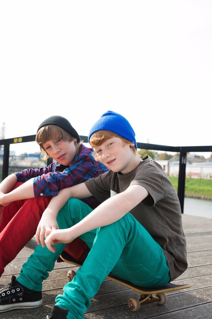 Stock Photo: 1828R-92162 Boys Sitting on Skateboards, Mannheim, Baden-Wurttemberg, Germany