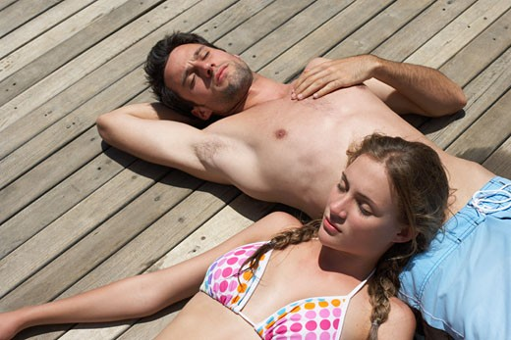 Stock Photo: 1828R-9253 Couple Lying on Dock