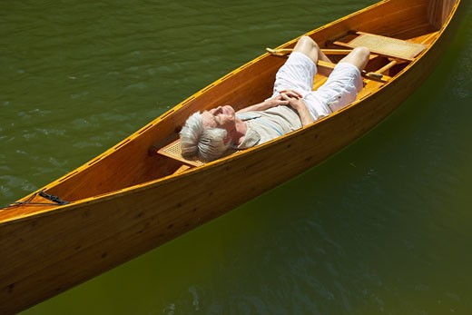 Stock Photo: 1828R-9265 Man Sleeping in Canoe