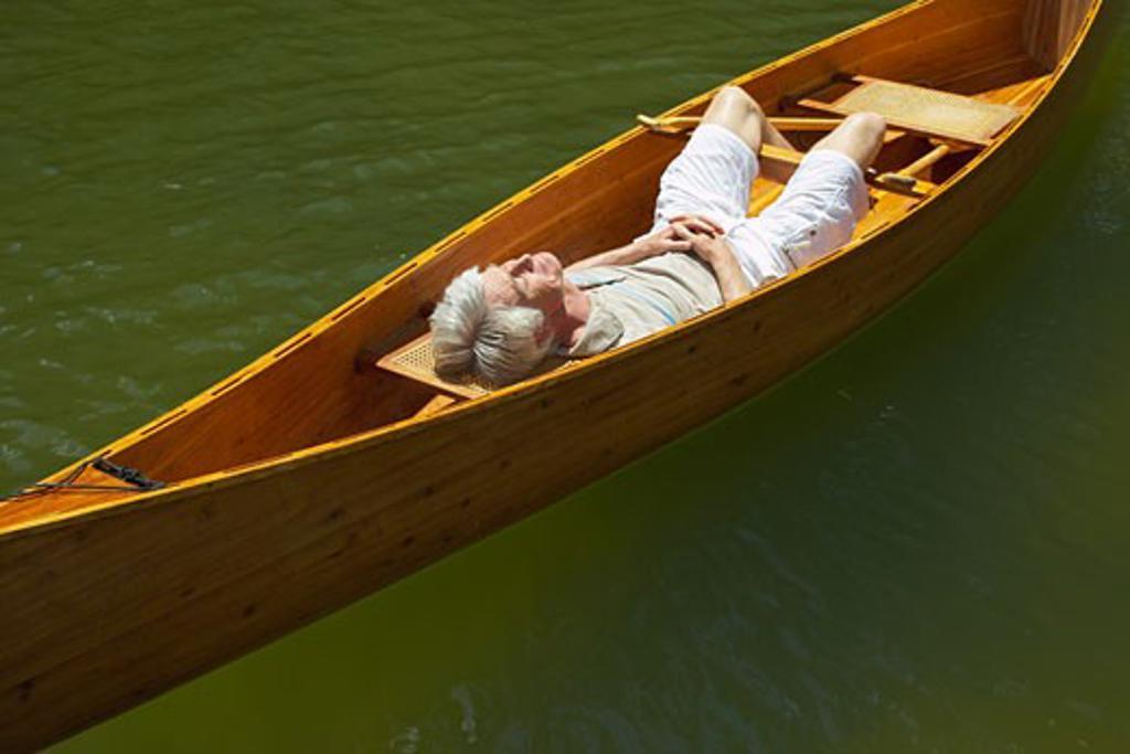 Man Sleeping in Canoe    : Stock Photo