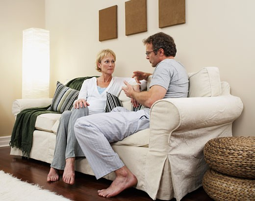 Stock Photo: 1828R-9543 Couple Talking on Sofa