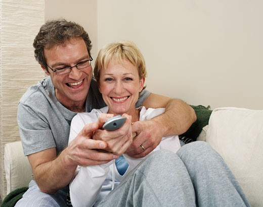 Stock Photo: 1828R-9546 Couple with Channel Changer