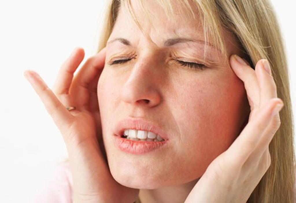Woman with Headache    : Stock Photo
