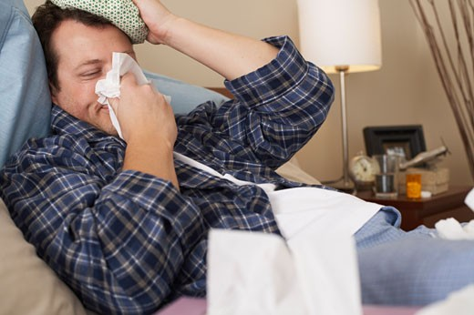 Stock Photo: 1828R-9755 Man Sick in Bed