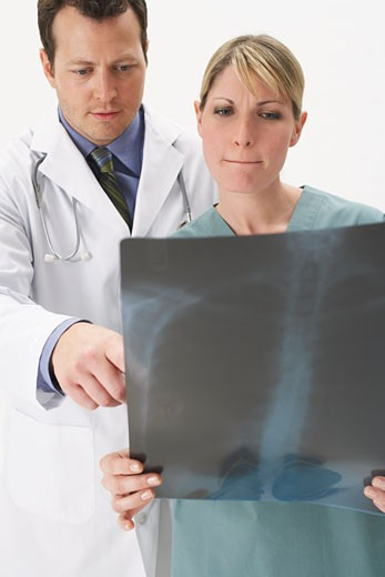Stock Photo: 1828R-9815 Portrait of Doctors Looking at X-Ray