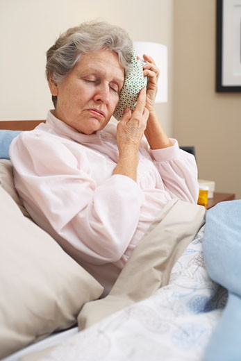 Stock Photo: 1828R-9829 Portrait of Woman Using Ice Pack