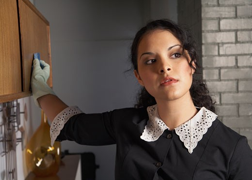 Stock Photo: 1828R-9910 Maid Cleaning House