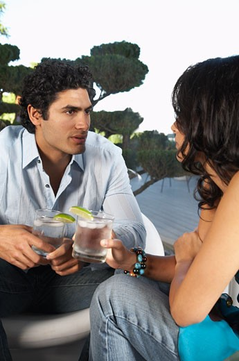 Couple Chatting Over Drinks    : Stock Photo