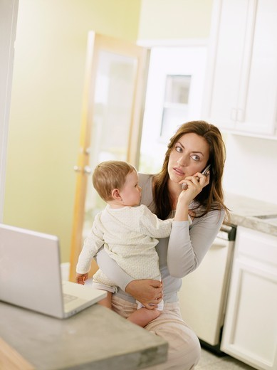 Busy Mother Working From Home : Stock Photo