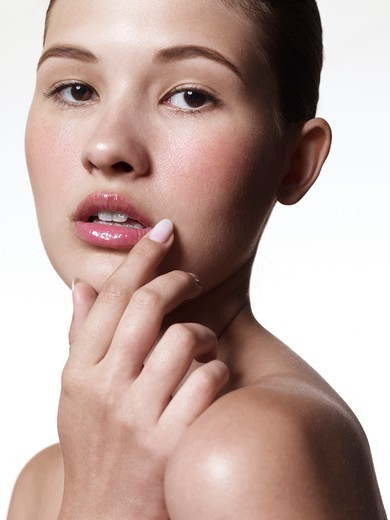 Woman with Hands on Face : Stock Photo