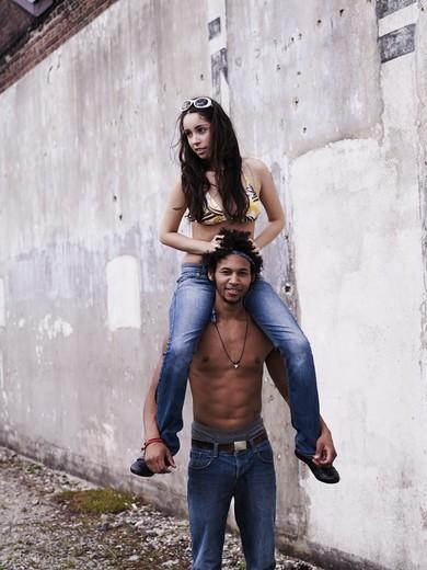 Young Man Giving Woman Piggyback Ride : Stock Photo
