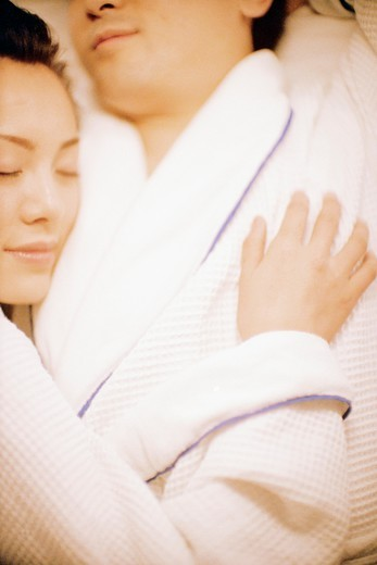 Couple Napping in Robes : Stock Photo