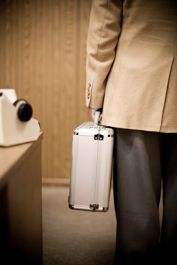 Businessman Holding Briefcase : Stock Photo
