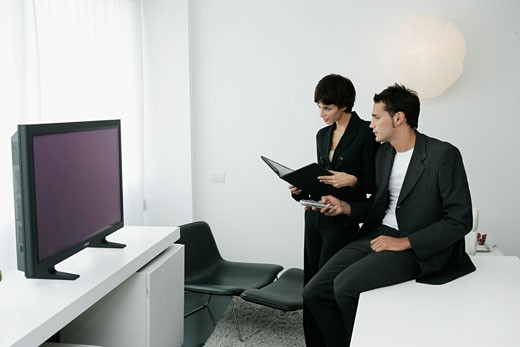 Businesspeople Looking at TV Screen : Stock Photo